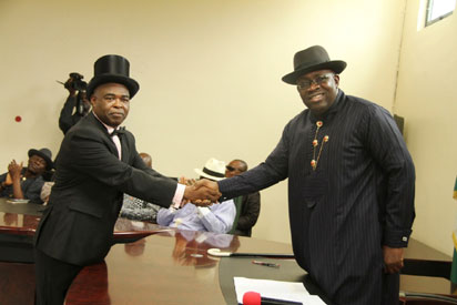 •Bayelsa State Governor, Hon. Seriake Dickson (right) congratulating Barr. Serena Dokubo-Spiff (left), shortly after being sworn in as the new Secretary to the Bayelsa State Government at Government House, Yenagoa. Photo by Lucky Francis.