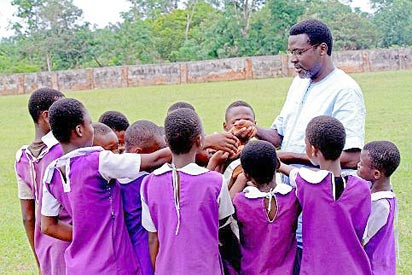 Onuesoke with children during his visit to schools