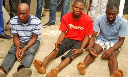 Suspected kidnapper of  three Lagos school girls, Emmanuel Arigidi (left) with two other conspirators paraded, yesterday in Lagos.