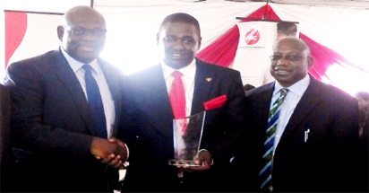 From left, Executive Secretary, Lagos State Technical Vocational and  Education Board, LASTVEB, Engr. Gasper Olawumi, Managing Director, Nigerian Bottling Company, NBC, Ltd, Mr.Ben Langat and Director, LASTVEB, Engr. Laolu Oguntuyi presenting an award of excellence to the outgoing MD during the NBC, TTC 25th graduation ceremony in Lagos.