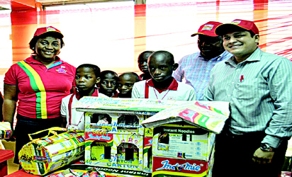 "L-R: Coordinator, Indomie Fans Club, Mrs. Faith Joshua; pupils of Great God Academy, Ogun State; Group Public Relations And Events Manager, Dufil Prima Foods Plc, Mr. Tope Ashiwaju; and Marketing Director, Dufil Prima Foods Plc, Girish Sharma, at the Indomie ""Team Yourself Up"" competition in Lagos."