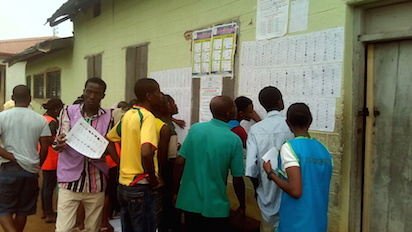 People checking for their names at polling unit 010 ward 2, Sacred Heart RC Primary School II.Akure .Photo.AKEEM SALAU