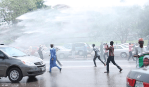 Police Tear Gas El-Zakzaky Protesters in Abuja with Water Canons.