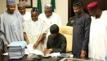 Image result for Osinbajo signs 2017 budge 2017 budget