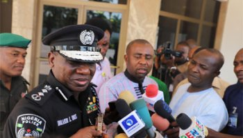 Image result for IGP avoids questions from journalists after meeting Buhari