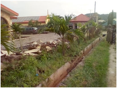 •A house partially demolished by the landgrabbers