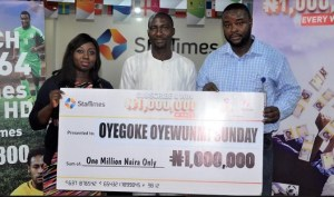 Content Marketing Manager, StarTimes Nigeria, Abosede Adewara; N1million prize winner, Oyegoke Sunday and a representative of National Lottery Regulatory Commission, Ibukunoluwa Bamidele during the cash prize presentation to Oyegoke at StarTimes office in Lagos.