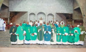 Catholic Bishop of Nsukka Diocese, Most Rev. Godfrey Igwebuike Onah flanked by some priests in the Diocese