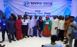 •Wife of Bauchi State Governor, Hajiya Hadiza Mohammed Abubakar, represented by the Bauchi State Commissioner for Women Affairs and Child Development, Barrister Ruqayat Ibrahim Kewa (middle displaying her award) in group photograph with some of the participants at the summit.