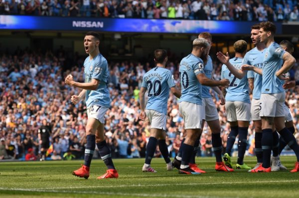 Man City gain revenge on Spurs to remain in control of title race