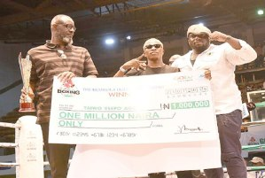 L-R: Vice President, Nigeria Basketball Federation, Babs Ogunade, Taiwo 'Esepo' Agbaje and his manager, Ajibade Ogunjokun after the boxer was presented with the Mojisola Ogunsanya Memorial Trophy and the N1m cheque replica.