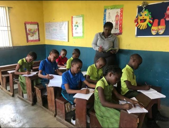 Teacher MaryJane Ikeakaonwu teaches in Bridge International Academies