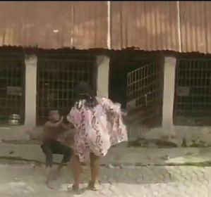 Woman locks boy in dog cage
