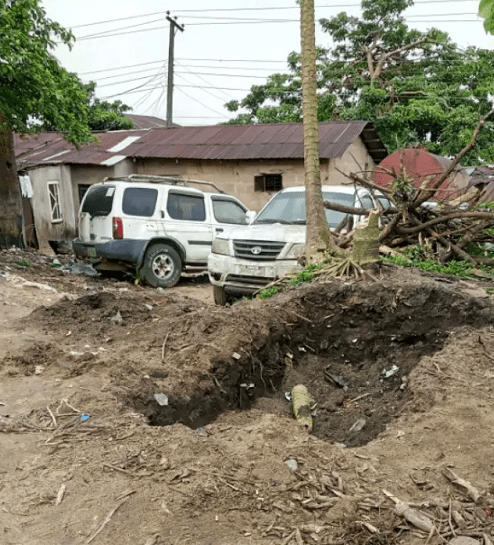 Village Head allegedly jumps into grave, stops children from burying parents