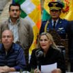 Bolivia edges toward peace as torn country mourns its dead