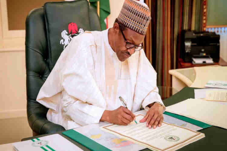 Image result for Buhari signs Finance bill into law