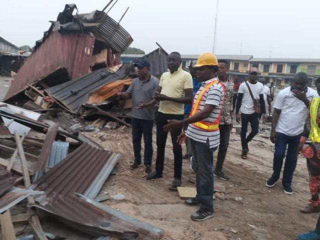 Cross River State Commissioner for Environment Mr Mfon Bassey right during the demolition exercise e1579423182684