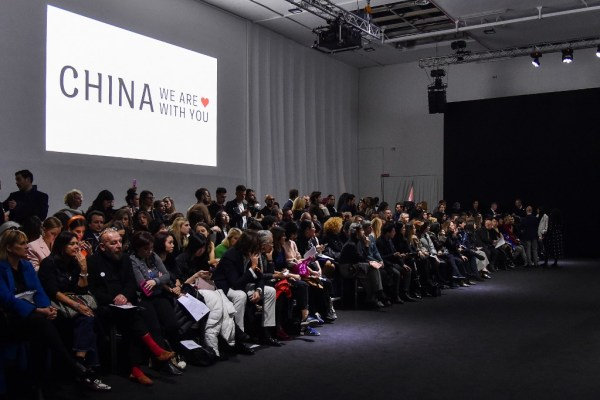 Milan fashion week carries on despite virus proximity