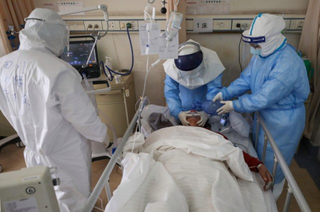UK coronavirus deaths surge past 1,000