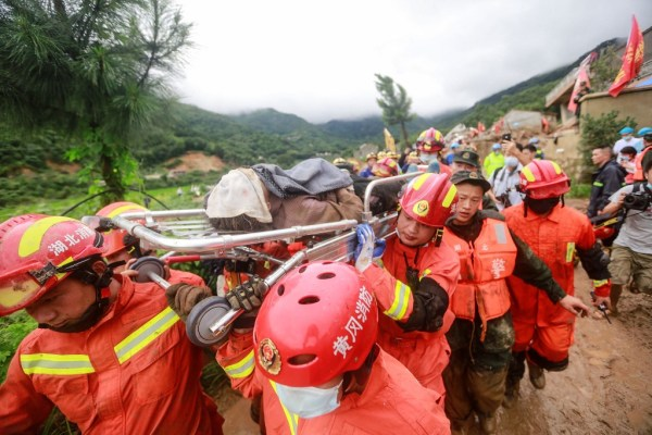 Landslides leave at least 14 dead or missing in China