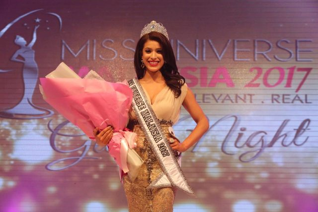 Malaysian ex-Miss Universe sorry over protest remarks