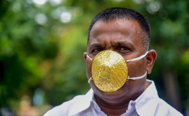 Indian man wears '$4,000' gold face mask to ward off coronavirus