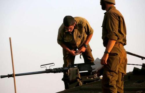 Israeli army says it hit squad placing explosives along Syria border