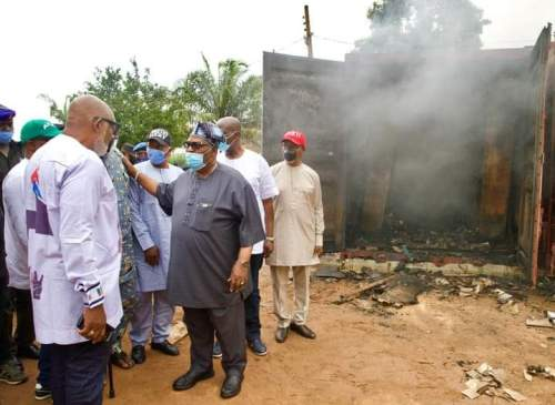 Gov Rotimi Akeredolu and the State REC, Ambassador Rufus Akeju during the governor's visit to the INEC office in Akure gutted by fire.