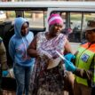 South Africa police arrest thousands for not wearing masks