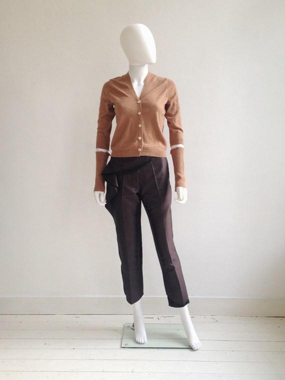 Maison Martin Margiela permanently creased orange cardigan with separate detached sleeves — fall 1990   Haider Ackermann purple pelum trousers — runway 2010   shop at vaniitas.com