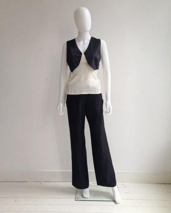 Ann Demeulemeester black wide trousers | Ann Demeulemeestre white bondage strap top — spring 2003 | Ann Demeulemeester black waistcoat — spring 2003 | shop at vaniitas.com