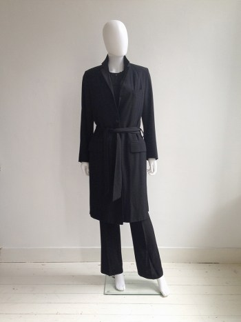 Dries Van Noten black long belted coat | Dries Van noten black waistcoat | Ann Demeulemeester black trousers | Nicolas Andreas Taralis black muscle tee | shop at vaniitas.com