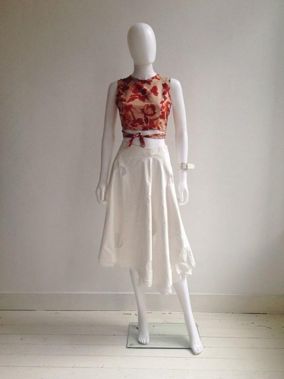 Dries Van Noten red floral wrap top — fall 1994 | Dirk Schonberger white skirt | Lieve Van Gorp white leather bracelet | shop at vaniitas.com
