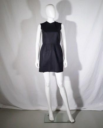 vintage Comme des Garçons black dress with padded hips — fall 1998