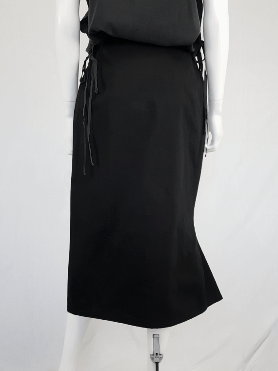 Yohji Yamamoto black structured skirt with sideways curve.