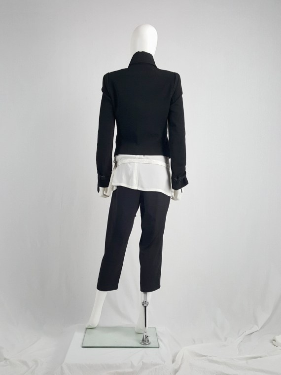 Ann Demeulemeester black asymmetric jacket with double button rows — fall 2010