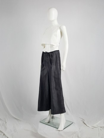 Ann Demeulemeester denim maxi skirt mimicking oversized trousers — spring 1991
