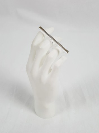 Margiela MM6 clear ring with silver strip across the fingers — spring 2013