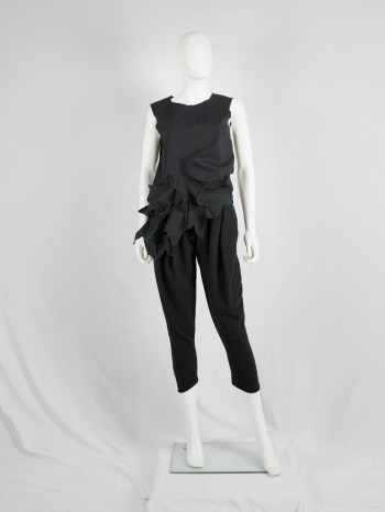 Comme des Garçons black sleeveless top with 3D stars at the hem — AD 2002