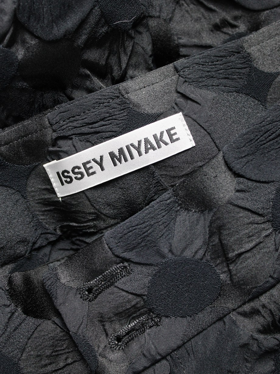 Issey Miyake black trousers with the fabric manipulated into different circles