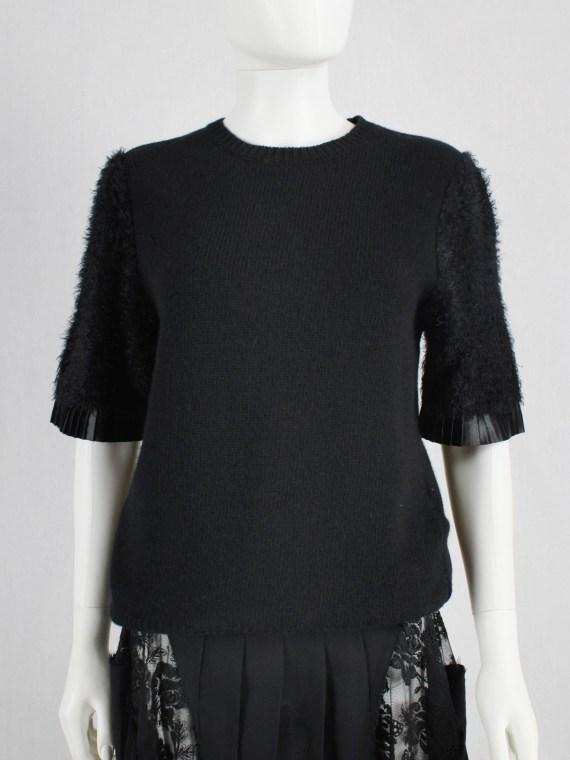 Noir Kei Ninomiya black knit top with fluffy sleeves and pleated trim — fall 2016