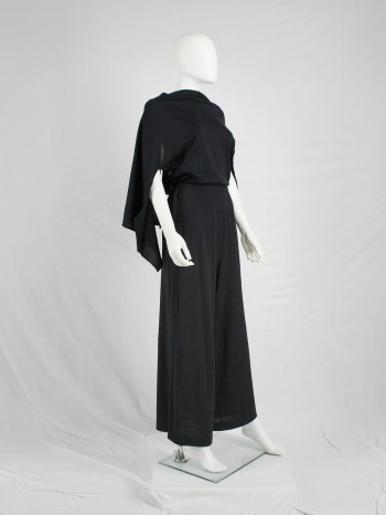 Comme des Garçons black jumpsuit with cape or bow at the back — AD 1994