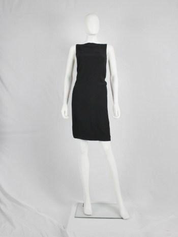 Ann Demeulemeester black slip dress with slit above the bust — fall 1997