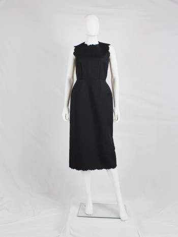 Comme des Garçons black dress with scalloped edges and wider hips — spring 1999