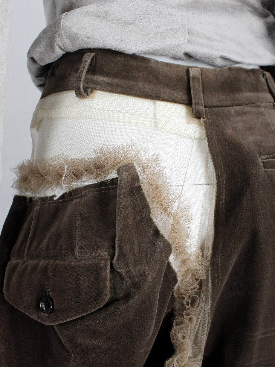 Comme des Garçons brown velvet shorts with cut off leg attached by sheer frills — spring 2007