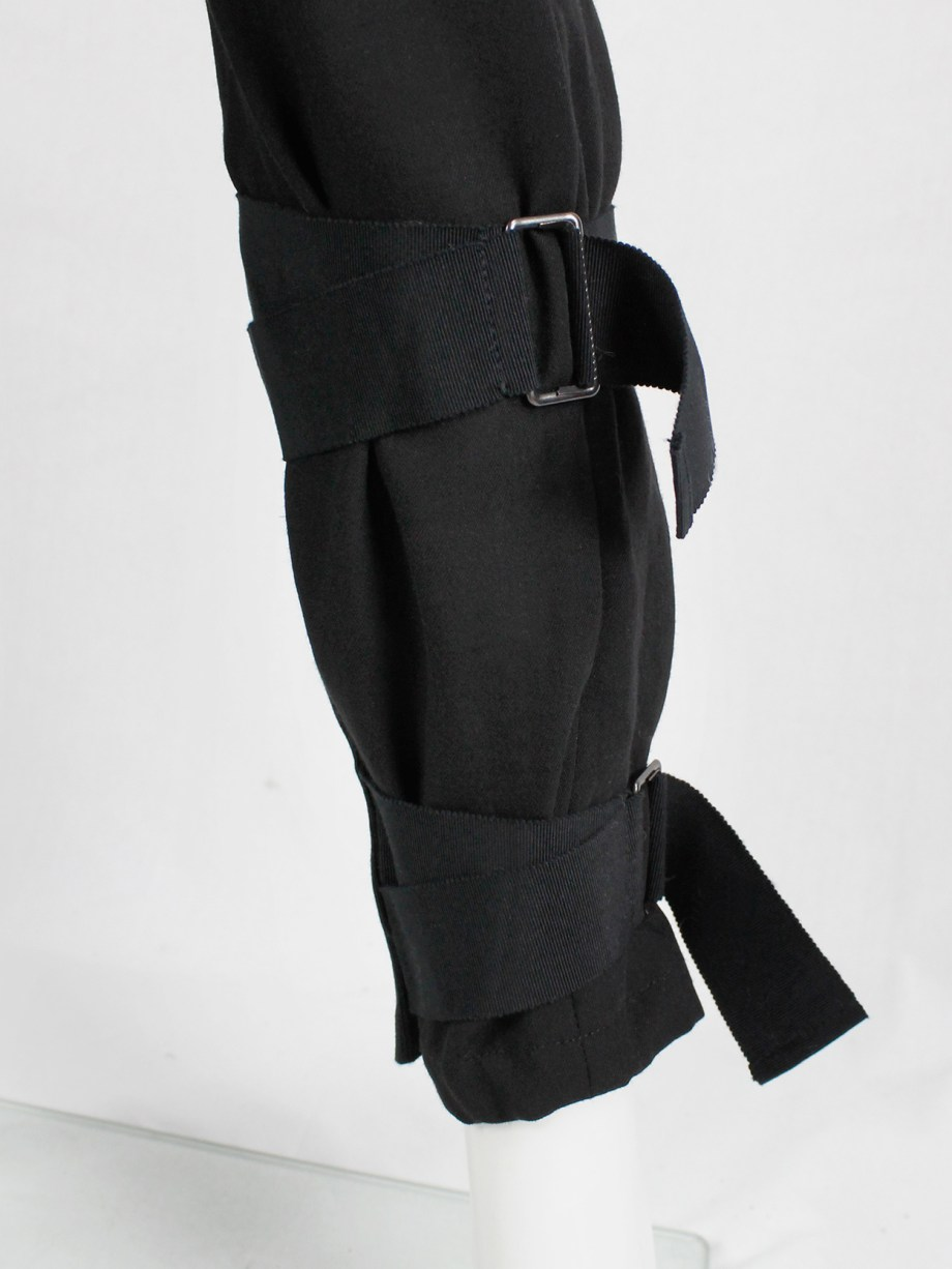 Ann Demeulemeester black trousers with wide belt straps around the ankles