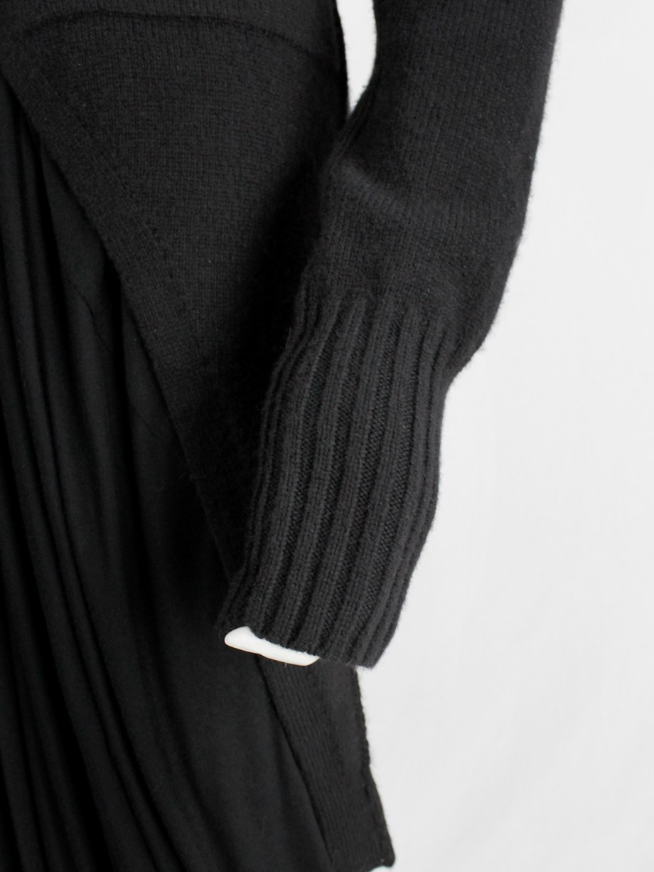 Ann Demeulemeester black long cutaway jumper with curved button closure — fall 2005