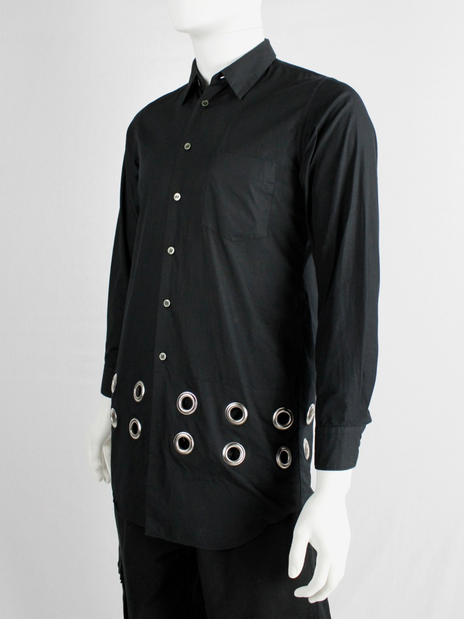 Comme des Garçons black shirt with rows of oversized silver eyelets — AD 2017