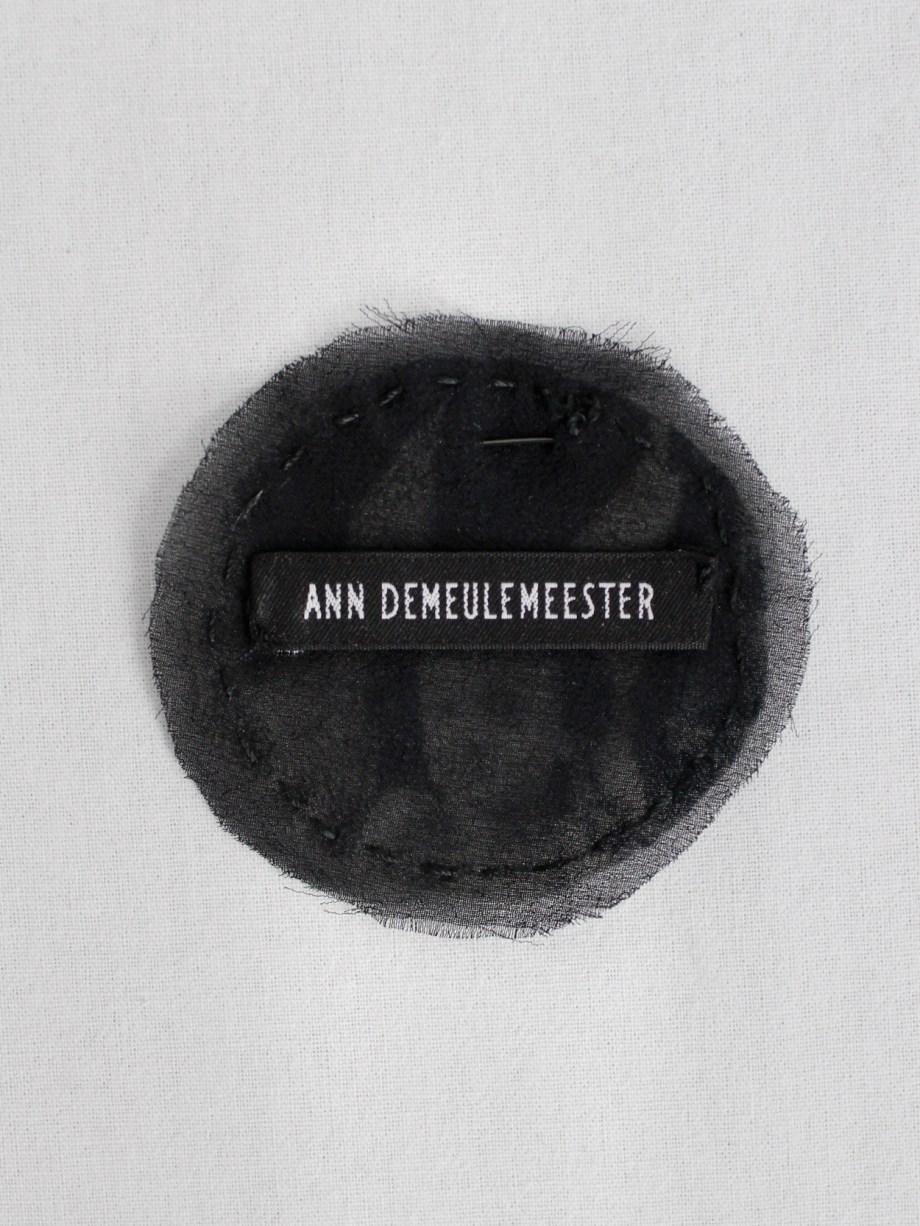 Ann Demeulemeester round pin brooch with cherub print — fall 2005