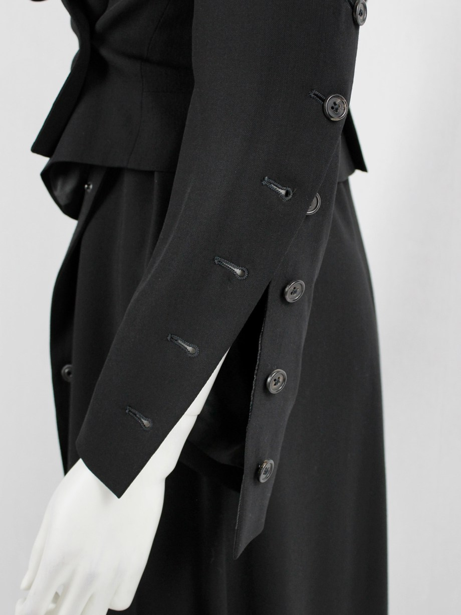 Ann Demeulemeester black jacket with buttons twisting around the sleeves — fall 2010